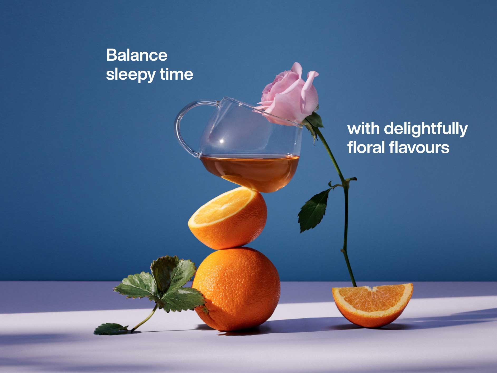 A cup of tea balanced on a stack of oranges
